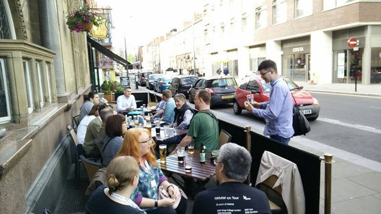 Pic of people drinking outside a pub
