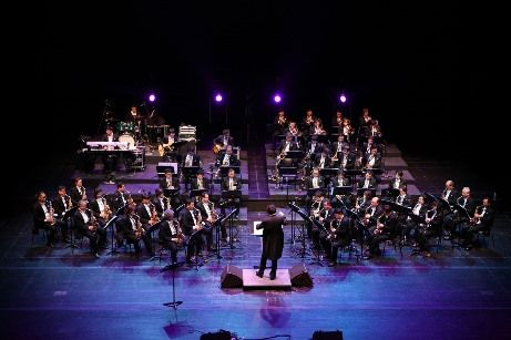 Image of an orchestra and conductor on stage